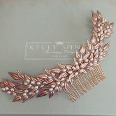 A large curved spray of rose gold plated leaves and clusters of freshwater pearls, set on a gold plated comb. Looks great worn at the back of the hair. Also ava