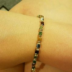 Silpada Designs bracelet Sterling silver bracelet. Earth tone stones on it. Never worn still new and in box just no tag. Silpada Jewelry Bracelets
