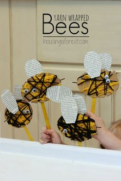 Yarn Wrapped Bee Puppet ~ using cardboard, black and yellow yarn, goggly eyes, glue, popsicle stick, and old book.