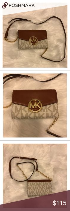 "NWOT Michael Kors Hudson Signature Crossbody Purse Brand New, without tags Authentic Michael Kors Hudson Signature Large Phone Crossbody Purse. I bought and never carried. In perfect condition. Material: Leather. Strap drop: 22""-25"". Magnetic closure. Chain and leather strap can be removed and purse can be carried as a clutch. Approximate Measurements: 7"" L x 5"" H x 1.25 D.   Trades/Holds Ships same day if PO is open Firm Price Michael Kors Bags Crossbody Bags"