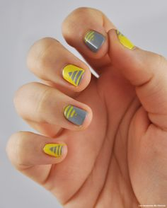 Grey and yellow triangle stripe nails