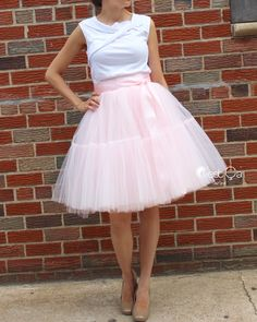 Extra puffy blush pink tulle skirt. 6 layers of fine semi-hard tulle. Lined. Regular midi length. Designed in New York. Handmade. Available in other colors.