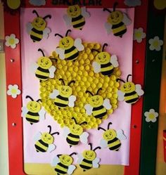 Spring bulletin board - here's the buzz. Use cut and painted paper towel rolls for hive