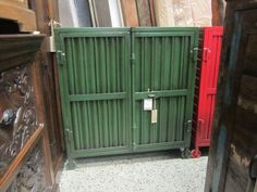 Green metal shipping container cabinet.  Measures:   33.25W 15.75D 36.25H. $402.