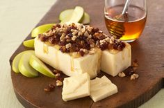 2  pkg. (10 oz. each) CRACKER BARREL Aged Reserve Extra Sharp Cheddar Cheese  1/4  cup honey  1/2  cup chopped PLANTERS Walnuts  1/2  cup chopped dates  1    apple, sliced