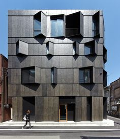 KURO Building by KINO Architects, Tokyo, Japan - The black shade overlaps panels of a concrete which painted different black, and gives various expression to the building.