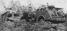 Tractor with Trailer retrieving an Sherman tank Dragon Wagon, Us Armor, Sherman Tank, Army Vehicles, Military Equipment, American Soldiers, Car Engine, World War Ii, Wwii