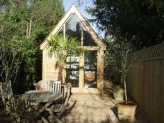 Adults deserve a playhouse too...This light filled outbuilding could serve as an office or just a quiet place to read some books.