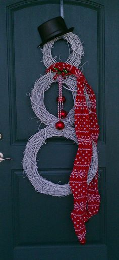 SUPPLIES NEEDED:    3 grapevine wreaths in 3 different sizes   holiday bells (I found a door hanger that I used)   wire (found mine at Wal-Mart)   wire cutter   scissors   holiday ribbon   black hat..