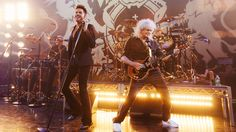 """Adam Lambert leads Queen through a setl list that included such fan favorites as  """"Under Pressure,"""" """"Fat Bottomed Girls"""" and """"We are the Champions"""" at the iHeartRadio Theater in Burbank. (1296×730)"""