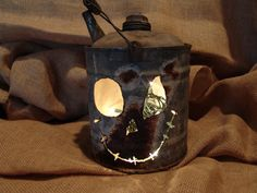 This listing is for an antique gas can that has been repurposed into a creative Fall / Halloween decoration! It is lit with standard string