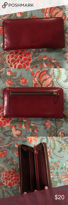 Wine red Fossil wallet! The leather has aged VERY well!!!! It was my favorite wallet! I just recently upgraded to a Kate Spade and I do not need it anymore. The cut on the bottom does not affect the wallet whatsoever. I bought it from poshmark like that. It is to prevent a return to fossil Store. Fossil Bags Wallets