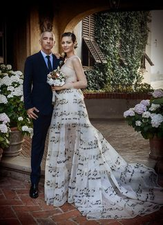 Eros Ramazzotti and Marica Pellegrinelli wedding. June 21st 2014. Original wedding dress. Music scale. Pentagram. Musical notes. Beautiful