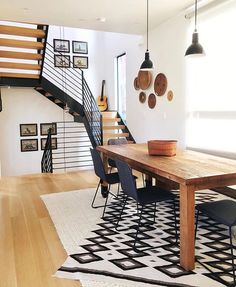 Love all the wood and black in this space | dining room ideas
