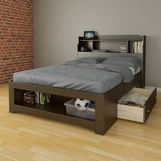 This Dixon 1-drawer storage bed with built-in bookcase headboard is perfect for any kids room. It features 1 drawer that can be installed on either side of the bed and an open storage space at the foot of the bed for extra storage. It's the perfect space for baskets, toys, shoes, clothing, blankets, and more. It fits a full size bed and the headboard features multiple shelves for books or displaying personal items.