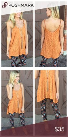 """Infinity Raine NWT tangerine twist wrap tunic NWT.  New Infinity Raine tangerine twist tunic.  Pairs great with spring leggings capris or shorts.  65% cotton 35 polyester. Length  sm-28, med 29, large 30.  Bust sm 18"""", med 19"""" and large 20"""".   To cute. Infinity Raine Tops Tunics"""