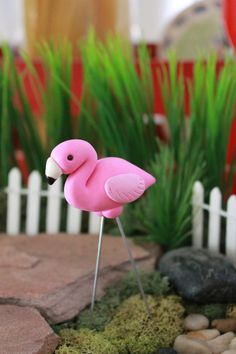 This listing is for ONE (1) hand sculpted polymer clay pink flamingo. Each flamingo is approximately 3 tall with wire legs. If desired the legs can be