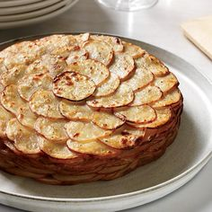 Healthy Potato Gratin with Herbs   Inspired by a potato gratin at Restaurant Daniel in New York City, this creamy—but creamless—recipe gets great flavor from thyme and rosemary.