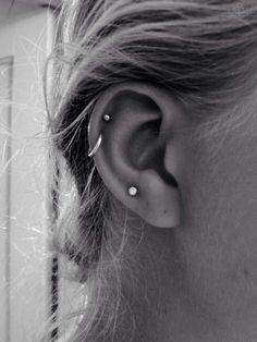 Stud and hoop helix piercing. on The Fashion Time  http://thefashiontime.com/5-cute-fun-ear-piercing-ideas/#sg9