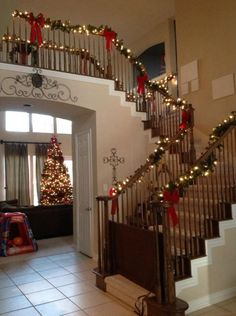 Christmas staircase decor- clearly my stairs do not look like this but could recreate on a smaller scale.