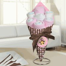 Could totally do this for center pieces. Use thick pink paper and choose a scrapbook paper pattern to add as well. Shape into cone, glue on bow, and fill. Cute! Pretty for a baby shower