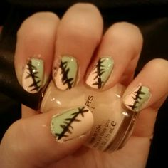 Pastel goth pink and green stitches nail art