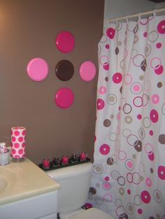 Pink and Brown Bathroom!!  Oooh Girly, Yet Modern, I LIKE!  Something different on the wall tho...