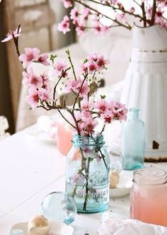 Simply beautiful centerpieces with cherry blossoms.