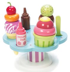 TYLER    HONEYBAKE CARLO'S GELATO PRICE: $34.95 Le Toy Van Scoop your luscious ice cream onto the funky cup or cone. Made from wood