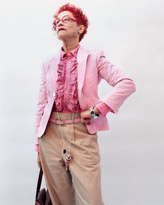 pink ruffles and seersucker with high waisted khaki pants.. not a huge fan of the necklace though