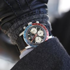 This vintage steel Heuer GMT 2446C Mark 4 with serial number 197 XXX from the late 1960s or early 1970s. It has its original fourth execution black dial with beautifully aged oversized registers. It also has its original iconic Pepsi bezel. Heuer introduced its first Autavia Chronograph in 1962. The introduction of the Heuer GMT followed soon after around 1969 complementing classic Heuer styling with vibrant newcolours. This fourth execution Heuer GMT 2446C has a reverse panda dial and…