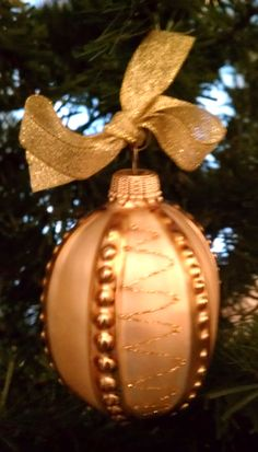 Small peach colored glass ornament