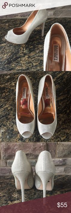 Badgley Mischka silver heels - only worn once! Only worn once Badgley Mischka silver heels in perfect condition! Price is negotiable, so if you're interested or have any questions please message me! Badgley Mischka Shoes Heels