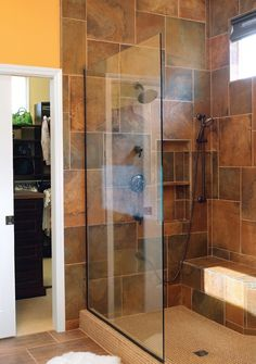 The #slate tile used in the master #bathroom #shower complements the golden tone of the textured walls. #housetrends