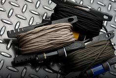 The Spool Tool for Paracord 550 - includes built in tools to store, cut and seal ends of cordage. ML: Great stuff. Despite everything else paracord, get one of this in each bag. Survival Tools, Camping Survival, Outdoor Survival, Survival Prepping, Paracord Knots, 550 Paracord, Bug Out Gear, Tac Gear, Parachute Cord