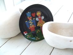 Vintage Enamel Dish Black Metal with Folk Art Toy Soldier and Ethnic Girl Painting by lookonmytreasures on Etsy