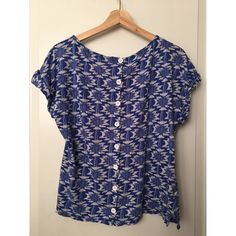 FREE W/ PURCHASE Royal Blue + White Swiss Top Adorable top with Swiss-style buttons up the back! Royal blue and white Aztec inspired design all over. Forever 21 Tops Blouses