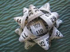 Repurpose old measuring tape pieces as bows. #DIY