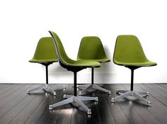 Eames olive upholstered side shell chairs on aluminum group bases