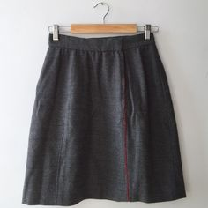 Grey Chloé Skirt Chloé grey a-line wool skirt with red piping down the front. Would look amazing with an over sized red flannel shirt and motorcycle boots or a dress shirt and pumps for the office. France size 40. Chloe Skirts