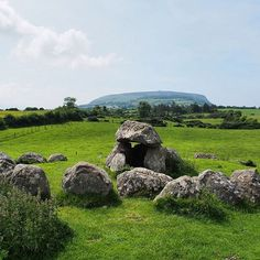 Carrowmore Megalithic Cemetery in County Sligo is one of the most densely populated complexes of megalithic tombs in Ireland . In the distance is Knocknarea and on top of that is Queen Maeve's Tomb, barely visible in this photo.  #Ireland #IFV