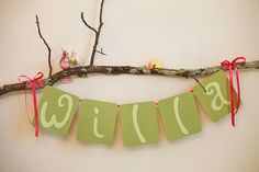 name garland hung on branch, by bootsieking, via Flickr