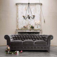 grey velvet chesterfield...ahh...im I'm love. If only my three children would not defile such a beauty.