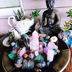Love this sacred space idea with the large bowl of crystals and gemstones and live plants surrounding.