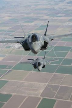 Two F-35B Lightning II Joint Strike Fighters with Marine Fighter Attack Squadron 121, 3rd Marine Aircraft Wing, fly in formation during a fixed-wing aerial refueling training exercise over eastern California, Aug. 27. The F-35Bs also practiced different tactics and break away formations. (USMC photo by: Cpl. Raquel Barraza)