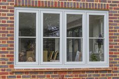 Solarlux SL Bi-Folding Doors, Halo Flush Double Glazed uPVC Windows and Apeer Composite Front Door, West End, Surrey - Thames Valley Windows Brick Cottage, Cottage Windows, House Windows, House With Grey Windows, Kitchen Windows, Aluminium Windows And Doors, Front Doors With Windows, Casement Windows, Sash Windows