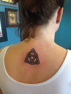 Trinity knot tattoo on back