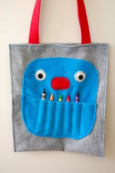 adorable! great idea for a busy bag. fill it with stuff for kids to do in waiting rooms
