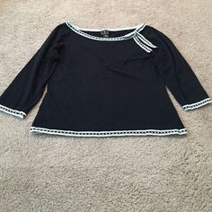 I.N.C. Black Scoop Neck Pullover Sweater I.N.C. Scoop Neck Black Pullover Sweater with a black and white bow and trim. Size L. Silk, Nylon, and Spandex. I.N.C. Sweaters Crew & Scoop Necks