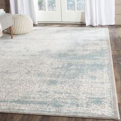 Safavieh Passion Watercolor Turquoise/ Ivory Distressed Rug (5'1 x 7'7) (PAS401B-5), Blue, Size 5' x 8' (Polypropylene, Geometric)